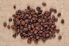 Coffee beans in a sacking background Stock Images
