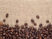 Coffee beans in a sacking background Royalty Free Stock Images