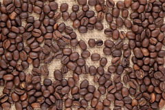 Coffee beans in a sacking background Royalty Free Stock Photo