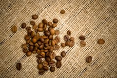Coffee beans on sacking texture Royalty Free Stock Image