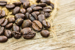 Coffee beans on sacking and wood Royalty Free Stock Photography
