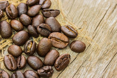Coffee beans on sacking and wood Stock Image