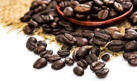 Coffee beans on sacking and wood spoon Stock Photo