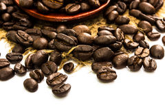 Coffee beans on sacking and wood spoon Royalty Free Stock Image