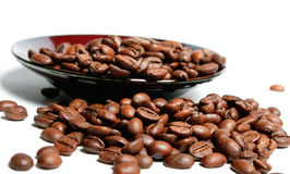 Coffee beans in a saucer. Stock Photos