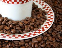 Coffee beans on saucer Royalty Free Stock Photo