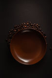 Coffee. Beans, saucer, , a pleasant evening,   around the plate Stock Images