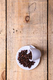 Coffee beans on a saucer Stock Images