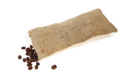 Coffee beans scattered. Roasted coffee beans scattered on rough sackcloth stock photography