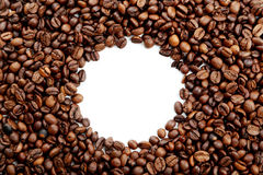 Coffee beans scattered around a circle Royalty Free Stock Photography