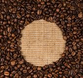 Coffee beans scattered on burlap. Can be used as background Royalty Free Stock Photography