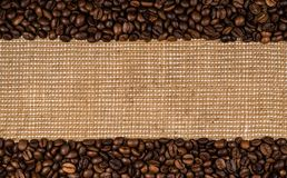 Coffee beans scattered on burlap. Can be used as background Stock Photography