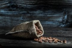 Coffee Beans Scattered From Sack Royalty Free Stock Photography