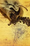 Coffee beans scattered on an old map of South America. View of the Coffee beans scattered on an old map of South America royalty free stock photography