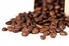 Coffee beans are scattered from stain-roof bank isolated Royalty Free Stock Photography