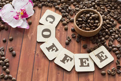 Coffee beans. Scattered on the table Royalty Free Stock Image