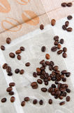 Coffee beans scattered on tablecloths Stock Image