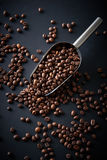 Coffee beans in a scoop on a black background Royalty Free Stock Image