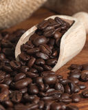 Coffee beans scoop sack Stock Photography