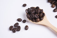 Coffee beans in scoop on white background.  Royalty Free Stock Photos