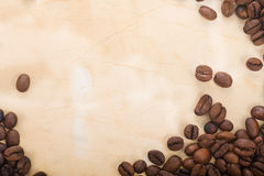 Coffee beans are in a semicircle on the old paper Stock Photo