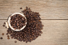 Coffee beans set up on wooden cask and rustic background.  Stock Photography