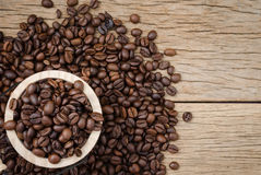 Coffee beans set up on wooden cask and rustic background.  Royalty Free Stock Image