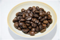 Coffee beans and shadow in little bowl Stock Photography