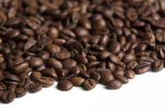 Coffee beans / shallow depth. Roasted coffee beans on white background. Shallow depth of field stock image