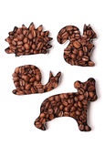 Coffee beans in the shape of animals on a white background. Isolated Royalty Free Stock Image