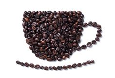 Coffee beans in the shape of a coffee mug with plate Stock Image