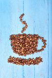 Coffee beans in the shape of a cup Royalty Free Stock Image