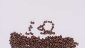 Coffee beans in shape of cup and smiley face stock video footage