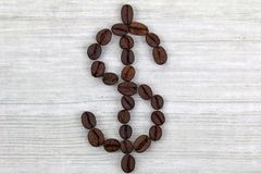 Coffee beans in a shape of Dollar sign Stock Images