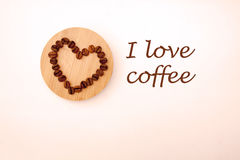 Coffee beans in a shape of a heart. Coffee beans on the Board Stock Photography