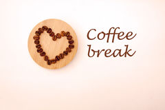 Coffee beans in a shape of a heart. Coffee beans on the Board Stock Image