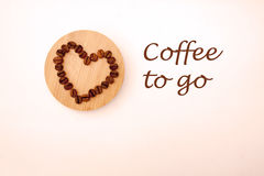 Coffee beans in a shape of a heart. Coffee beans on the Board Royalty Free Stock Image
