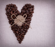 Coffee beans in the shape of a heart with bow Royalty Free Stock Photography