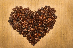 Coffee beans  in the shape of the heart. Royalty Free Stock Images