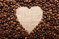 Coffee beans in shape of heart Stock Images