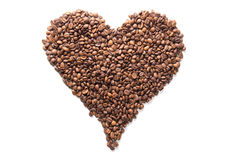 Coffee beans in the shape of a heart isolated on white Stock Photography