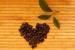Coffee beans in the shape of heart Stock Images