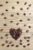 Coffee beans in shape of hearts Royalty Free Stock Image