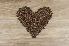 Coffee beans in the shape of a human heart Stock Images