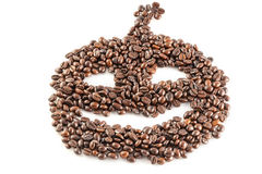 Coffee beans in shape of jack o lantern on the white background Royalty Free Stock Photography