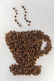 Coffee beans in shape of a mug. Close up of coffee beans forming a mug stock photo