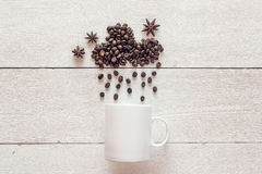 Coffee beans in shape of rainy cloud with anise stars and white Stock Photography