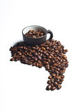 Coffee beans shaped like south america. And black cups stock images