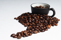 Coffee beans shaped like south america and black c Stock Photo