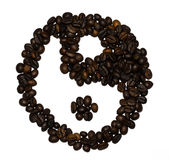 Coffee beans shaped into a yin and yang symbol Royalty Free Stock Photo